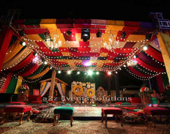 grand setup, colorful wedding, trussing with colorful fabric draping